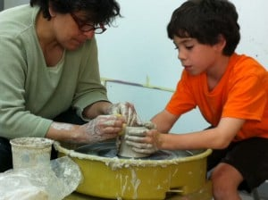 Jake learning to use the pottery wheel with The Arts instructor Gloria Kosco